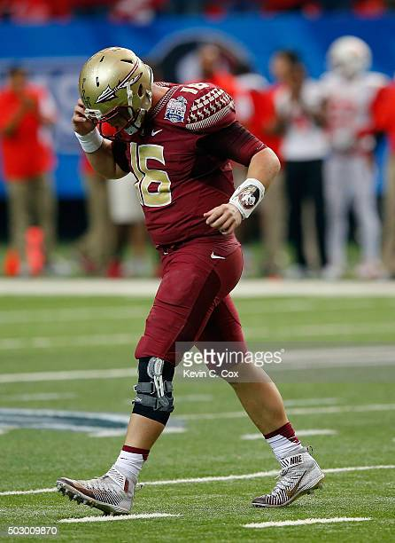 Quarterbak JJ Cosentino of the Florida State Seminoles walks off the field in the second quarter against the Houston Cougars during the ChickfilA...