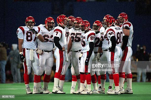 Quarterbck Boomer Esiason of the Cincinnati Bengals huddles with the offensive including Jim Riggs Joe Walter Mike Arthur Tim McGee Bruce Kozerski...