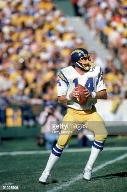 Quarterbck Dan Fouts of the San Diego Chargers looks to pass during a playoff game against the Miami Dolphins at Joe Robbie Stadium in Miami Florida...