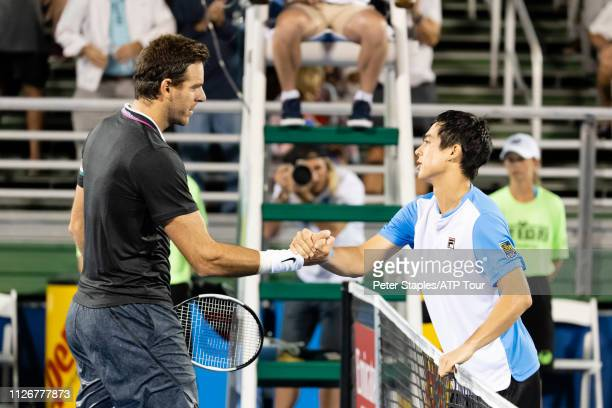 Quarterfinals match winner Mackenzie McDonald of USA shakes hands at the net with Juan Martin Del Potro of Argentina at the Delray Beach Open held at...