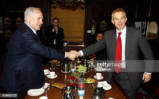 Quartet Middle East envoy Tony Blair shake hands with Israeli Likud party leader Benjamin Netanyahu on January 25 2009 in Jerusalem Israel