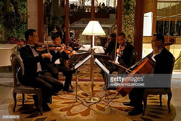 A quartet plays classical music in the lobby of the Mandarin Oriental Bangkok one of the world's best hotels