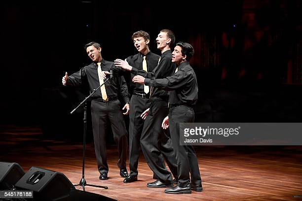 Quartet Singers Daniel Ramsey Michael Friedrich Adrian Lopez and Michael Adams of No Strings Attached perform onstage during the Youth Barbershop...