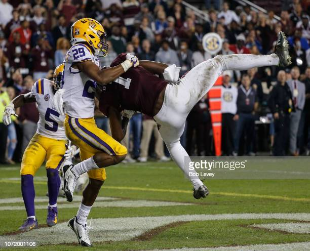 Quartney Davis of the Texas AM Aggies scores a touchdown in overtime as Greedy Williams of the LSU Tigers is late on coverage at Kyle Field on...