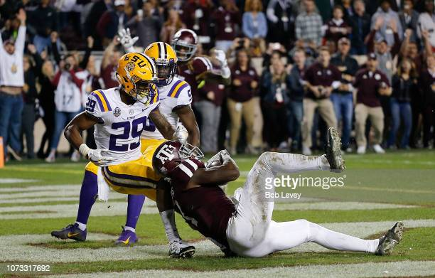 Quartney Davis of the Texas AM Aggies scores in the 7th overtime period as Greedy Williams of the LSU Tigers is unable to keep him from scoring at...