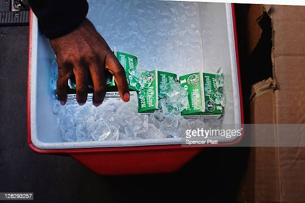 Quarts of milk are pulled from a cooler for the Milk from the Heart program which makes weekly deliveries to Washington Heights and 12 other...