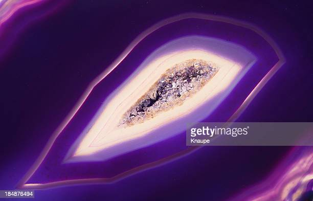 quartz crystal inside of purple banded agate - agate stock pictures, royalty-free photos & images