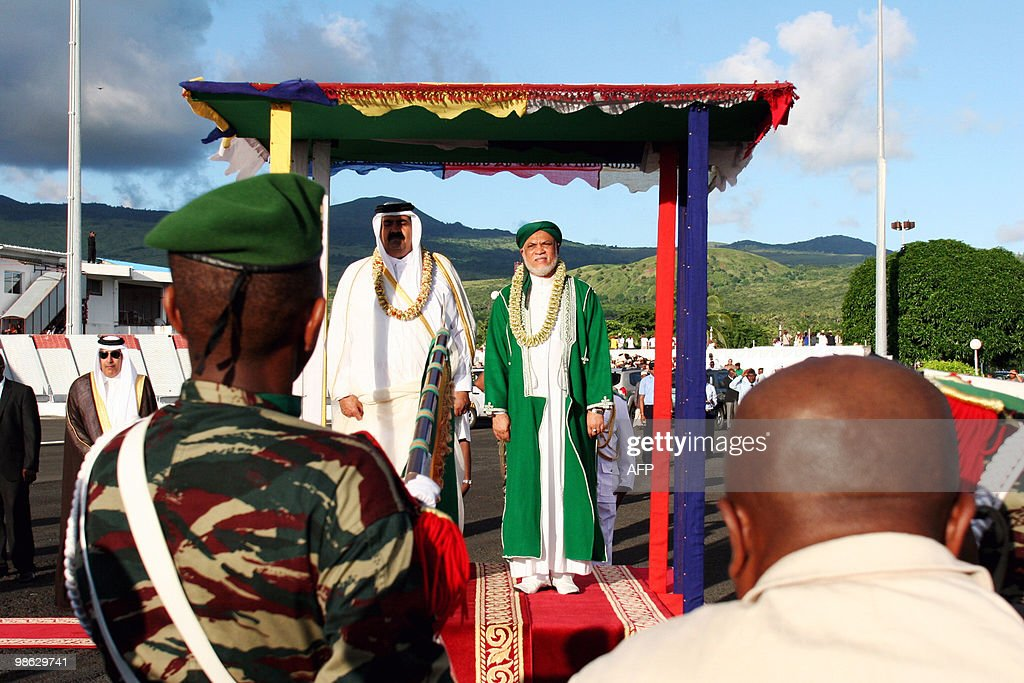 Quatar's Sheikh Hamad bin Khalifa al-Thani (C-L) and Comoros's current President Ahmed Abdalah Sambi (C-R) stand on a podium at the local airport in Anjouan, the Comoran Island on April 22, 2010. The emir of gas-rich Qatar said on a brief visit to the Comoros that his country would pay the salaries of the island nation's civil servants who have not been paid for months, an official said. It was the first official visit by an Arab head of state to the poor Indian Ocean archipelago, a politically tense Muslim state which has been rocked by more than 20 coups since independence from France in 1975.