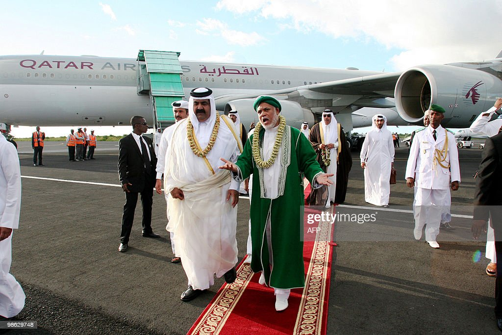 Quatar's Sheikh Hamad bin Khalifa al-Thani (L) is welcomed by Comoros's current President Ahmed Abdalah Sambi (R) upon arrival at Anjouan's airport, on the Comoran Island, on April 22, 2010. The emir of gas-rich Qatar said on a brief visit to the Comoros that his country would pay the salaries of the island nation's civil servants who have not been paid for months, an official said. It was the first official visit by an Arab head of state to the poor Indian Ocean archipelago, a politically tense Muslim state which has been rocked by more than 20 coups since independence from France in 1975.