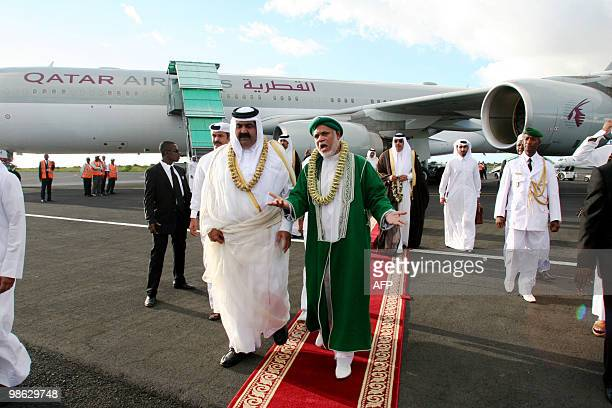 Quatar's Sheikh Hamad bin Khalifa alThani is welcomed by Comoros's current President Ahmed Abdalah Sambi upon arrival at Anjouan's airport on the...