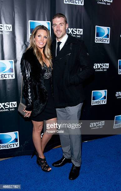 NFL quaterback Alex Smith and his wife Elizabeth Barry attend the DirecTV Super Saturday Night at Pier 40 on February 1 2014 in New York City