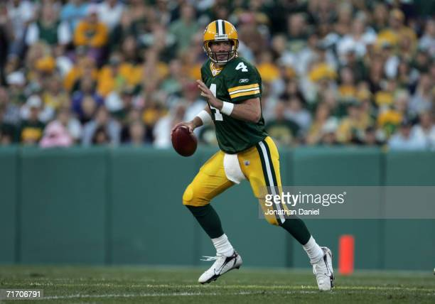 Quaterback Brett Favre of the Green Bay Packers scrambles with the ball during the preseason game against the Atlanta Falcons on August 19, 2006 at...