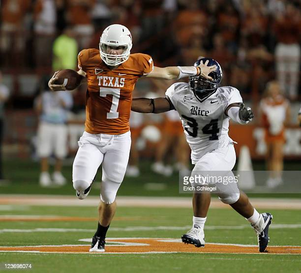 Quaterback Garrett Gilbert of the Texas Longhorns runs past linebacker Cameron Nwosu of the Rice Owls in the second quarter on September 3 2011 at...