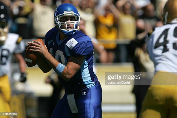 Quaterback Jake Swank of the Indiana State University Sycamores drops back to pass against the Purdue University Boilermakers on September 2 2006 at...
