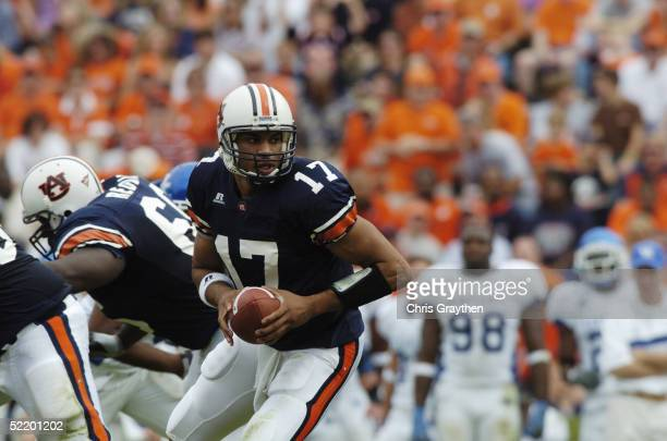 Quaterback Jason Campbell of the Auburn University Tigers handsoff the ball against the University of Kentucky Wildcats on October 23 2004 at...