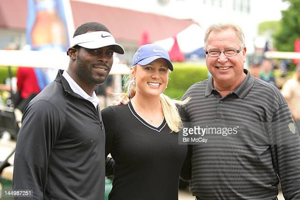 NFL Quaterback Michael Vick LPGA Player Amanda Blumenherst and host Ron Jaworski pose at the 28th Annual Celebrity Golf Challenge Hosted By Ron...