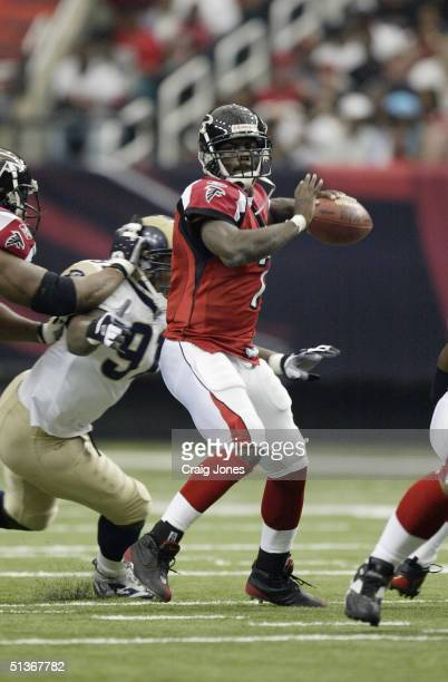 Quaterback Michael Vick of the Atlanta Falcons passes the ball during the game against the St. Louis Rams at the Georgia Dome on September 19, 2004...