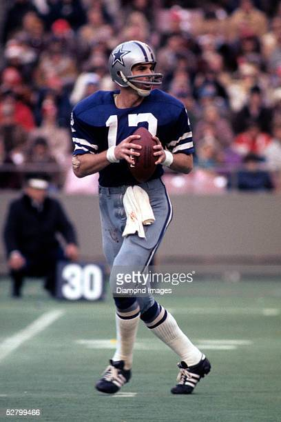 Quaterback Roger Staubach of the Dallas Cowboys drops back to pass during a game in 1975