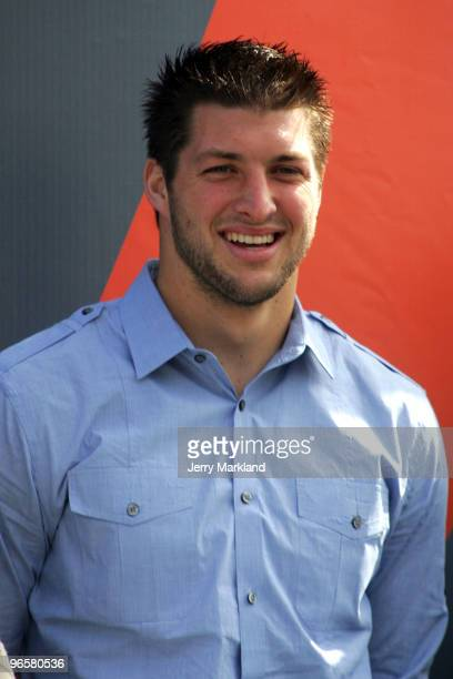 Quaterback Tim Tebow of the Florida Gators stands onstage before the first NASCAR Sprint Cup Series Gatorade Duel at Daytona International Speedway...