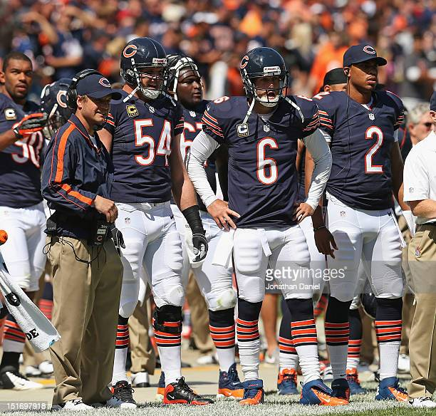 Quaterbacks coach Jeremy Bates Brian Urlacher Jay Cutler and Jason Campbell of the Chicago Bears watch from the sidelines against the Indianapolis...
