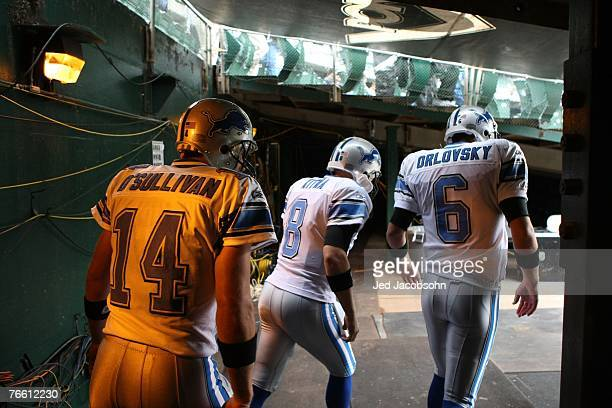 Quaterbacks JT O'Sullivan Jon Kitna and Dan Orlovsky of the Detroit Lions enter the field prior to their game against the Oakland Raiders on...
