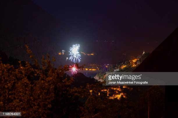 quatorze juillet fireworks in french alps - bastille day stock pictures, royalty-free photos & images