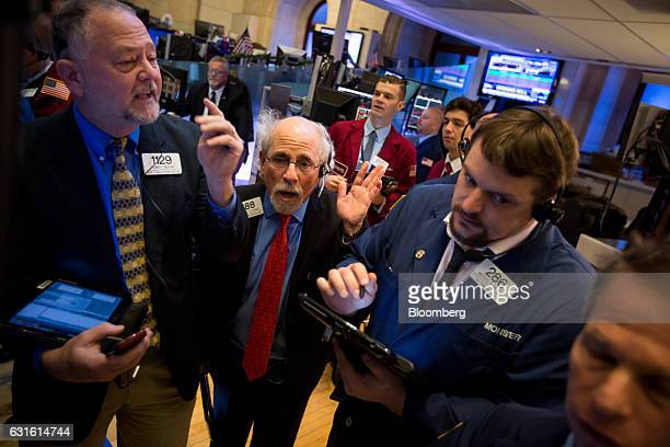 Quattro M Securities trader Peter Tuchman center left works on the floor of the New York Stock Exchange in New York US on Friday Jan 13 2017 US...