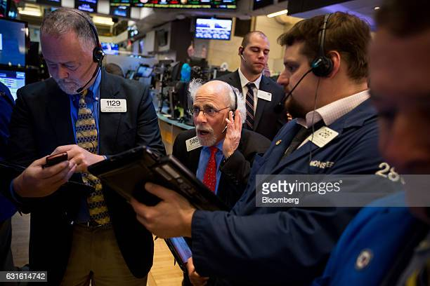 Quattro M Securities trader Peter Tuchman center works on the floor of the New York Stock Exchange in New York US on Friday Jan 13 2017 US stocks...