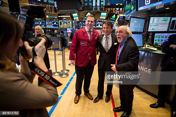 Quattro M Securities trader Peter Tuchman right stands for a photograph with his son Benjamin Tuchman center left and Robert Herjavec founder and...