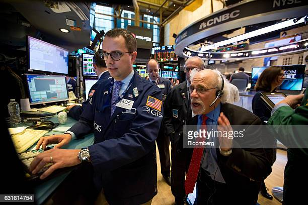 Quattro M Securities trader Peter Tuchman right works on the floor of the New York Stock Exchange in New York US on Friday Jan 13 2017 US stocks rose...