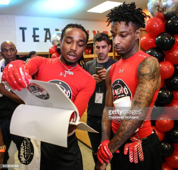 Quavo and 21 Savage go over plays before the game at Huncho Day at Berkmar High School on April 1 2018 in Lilburn Georgia