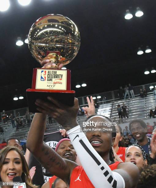 Quavo raises the 'Celebrity AllStar MVP Trophy' during the 2018 NBA AllStar Game Celebrity Game at Los Angeles Convention Center on February 16 2018...
