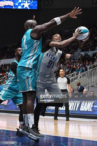 Quavo shoots against Mike Colter during the 2019 NBA AllStar Celebrity Game at Bojangles Coliseum on February 16 2019 in Charlotte North Carolina