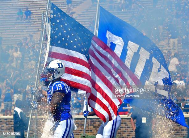 Quay Chambers of the Duke Blue Devils leads the team onto the field during the game against the Baylor Bears at Wallace Wade Stadium on September 16...