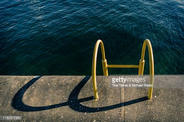 quay wall with yellow ladder - beschaulichkeit stock pictures, royalty-free photos & images