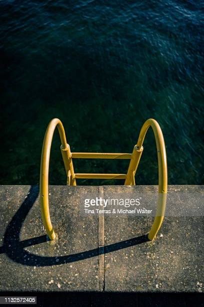 quay wall with yellow ladder - schattig stock pictures, royalty-free photos & images