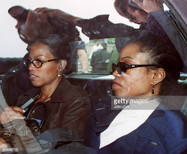 Qubilah Shabazz and her sister Illayasah wait in a car 03 June outside family court in Yonkers after attending a court hearing for Qubilah's son...
