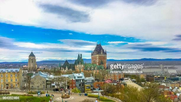 quebec canada: urban skyline including the chateau frontenac during the day with a dramatic sky - chateau frontenac hotel stock pictures, royalty-free photos & images