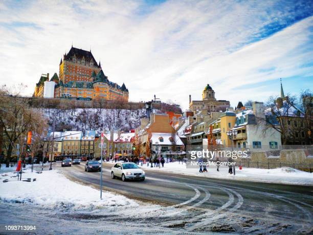 quebec city chateau frontenac and old city back lit skyline in winter at sunset - chateau frontenac hotel stock pictures, royalty-free photos & images
