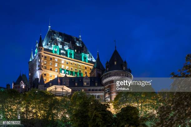 quebec city chateau frontenac at twilight in summer, canada - chateau frontenac hotel stock pictures, royalty-free photos & images