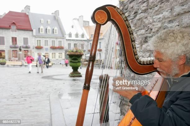 Quebec City Lower Town Rue Saint Pierre man plays harp