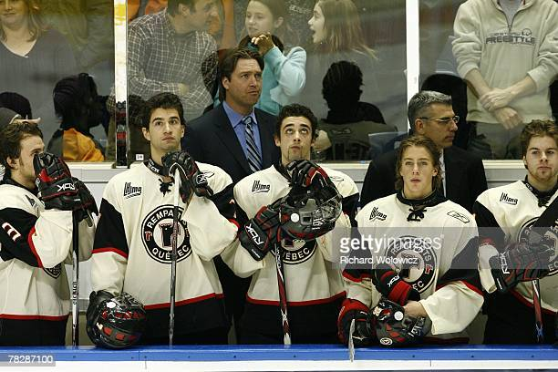 Quebec City Remparts head coach Patrick Roy and his son Frederick Roy stand during the playing of the national anthem at Colisee Pepsi on December...