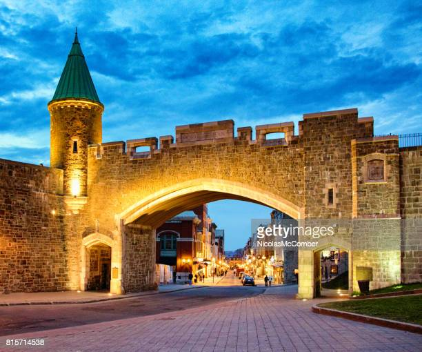 Quebec City Saint-Jean stone gate at dusk with street scene behind