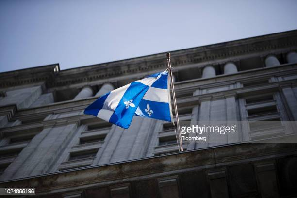 A Quebec flag flies outside the Sun Life building in Montreal Quebec Canada on Monday Aug 20 2018 Median singlefamily home prices in Montreal...