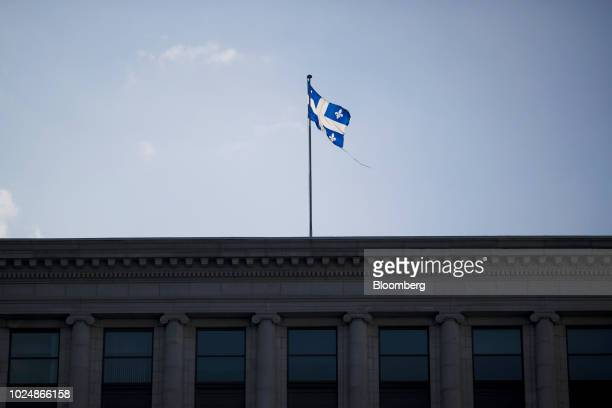 A Quebec flag flies over the Bank of Montreal headquarters in Montreal Quebec Canada on Monday Aug 20 2018 Median singlefamily home prices in...
