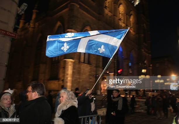 Quebec flag is seen during the State Funeral Service for Celine Dion's Husband Rene Angelil at NotreDame Basilica on January 22 2016 in Montreal...