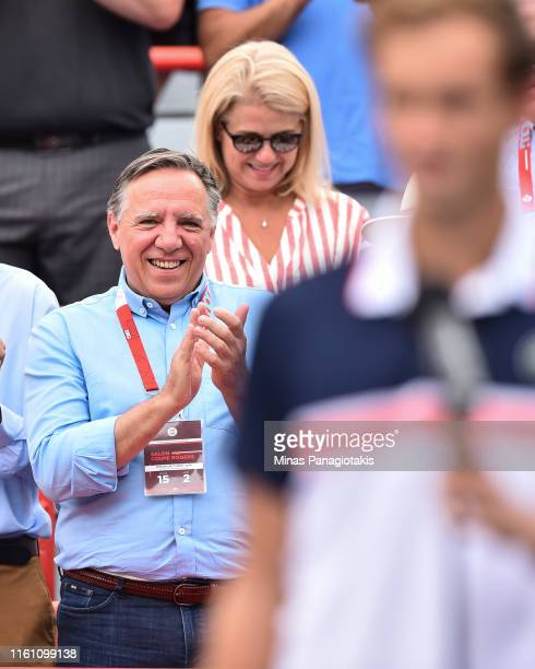 Quebec Premier Francois Legault cheers on Daniil Medvedev of Russia in his match against Rafael Nadal of Spain during the mens singles final on day...