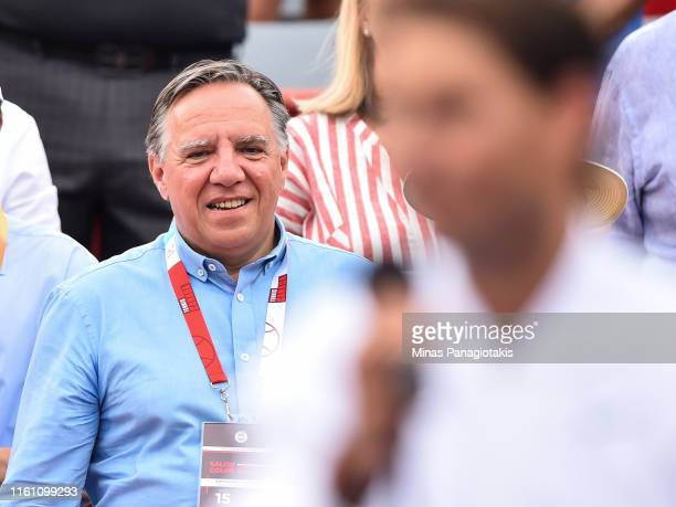 Quebec Premier Francois Legault listens in to Rafael Nadal of Spain as he addresses the fans after his win against Daniil Medvedev of Russia during...