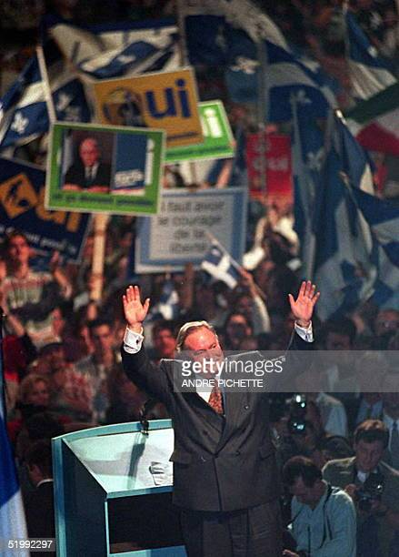 Quebec Premier Jacques Parizeau receives a warm welcome October 25 during a YES rally supporters wave Quebec flags and posters Wednesday in Montreal...