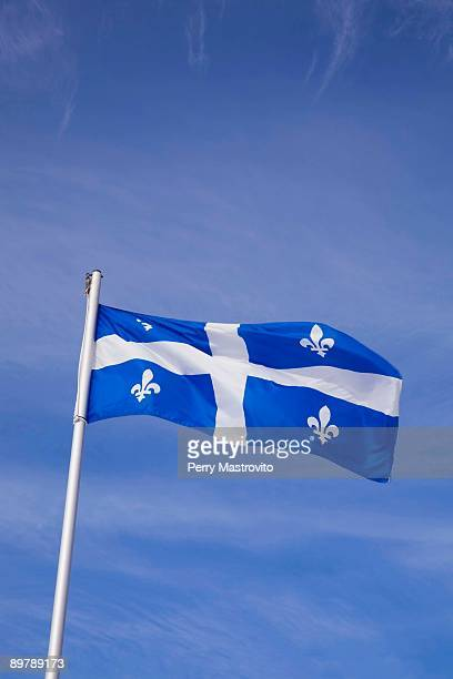 Quebec provincial flag blowing in the wind